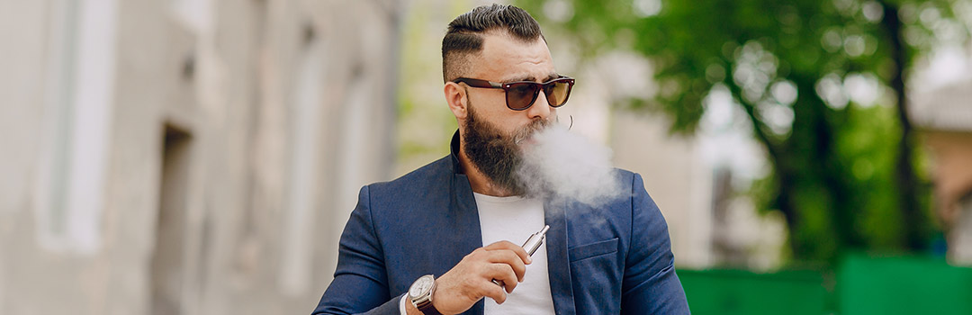 guy smoking an e-cigarette